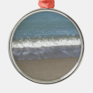 Wave of the sea on the sand beach Silver-Colored round ornament