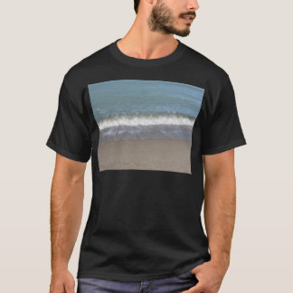 Wave of the sea on the sand beach T-Shirt
