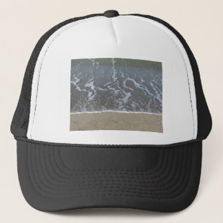 Wave of the sea on the sand beach trucker hat