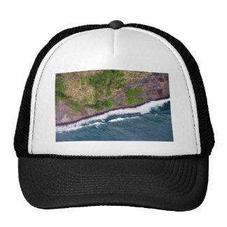 Wave splash gently touching the cliff trucker hat