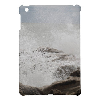 Waves breaking on rocks iPad mini cases