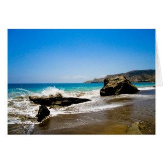 Waves crash on beach card