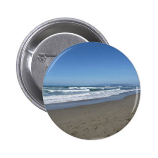 Waves of the sea on the sand beach 2 inch round button