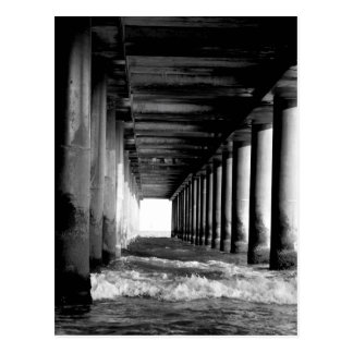 waves under a pier black and white postcard