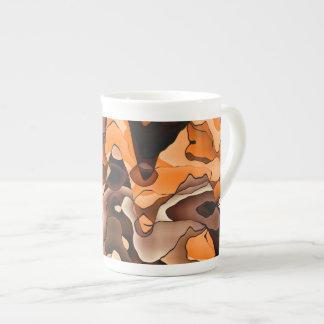 Wavy orange and brown tea cup