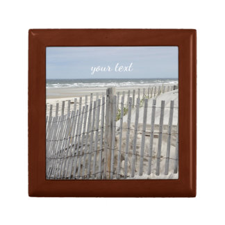 Weathered beach fence and ocean beach gift box