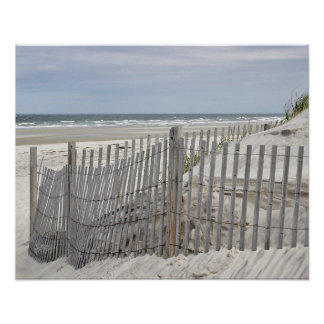 Weathered beach fence and ocean beach poster