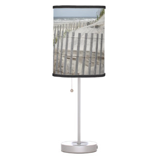 Weathered beach fence and ocean beach table lamp