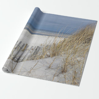 Weathered beach fence and ocean beach wrapping paper
