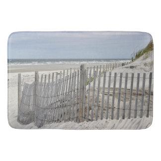 Weathered beach fence and sand dune bath mat
