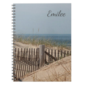 Weathered beach fence in the sand dunes note books