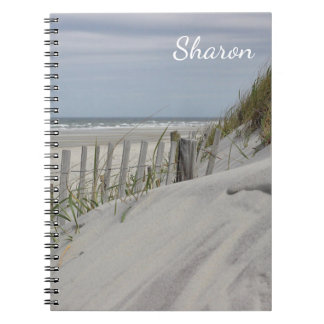 Weathered beach fence in the sand dunes notebook