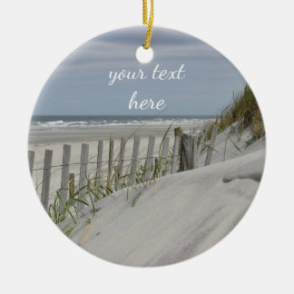 Weathered fence and sand dunes at the beach ceramic ornament