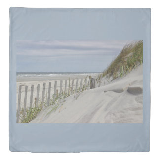 Weathered fence and sand dunes at the beach duvet cover