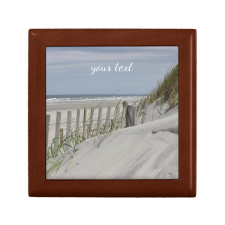 Weathered fence and sand dunes at the beach gift box