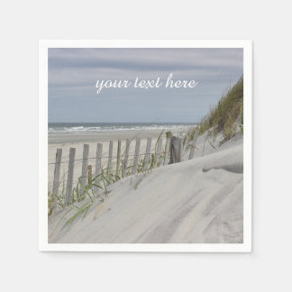 Weathered fence and sand dunes at the beach paper napkin