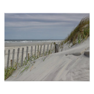 Weathered fence and sand dunes at the beach poster