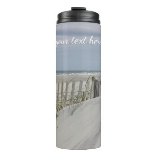 Weathered fence and sand dunes at the beach thermal tumbler