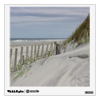 Weathered fence and sand dunes at the beach wall sticker