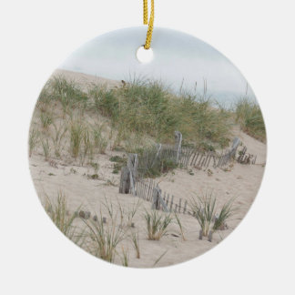 Weathered fence in the dunes round ceramic ornament