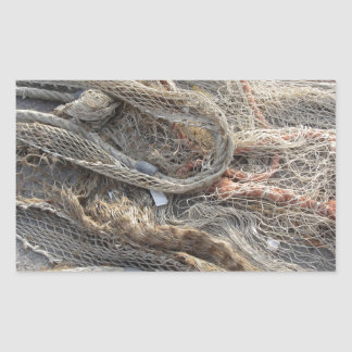 Weathered fishing nets on a harbor pier