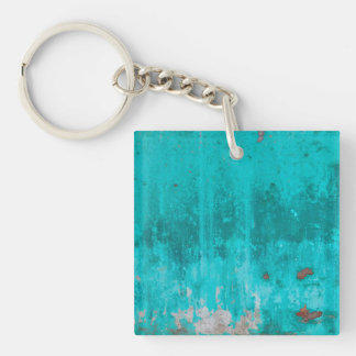 Weathered turquoise concrete wall texture keychain