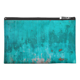 Weathered turquoise concrete wall texture travel accessories bag