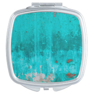 Weathered turquoise concrete wall texture travel mirror