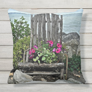 """WEATHERED WOODEN CHAIR WITH PETUNIAS ALONG LAKE"" OUTDOOR PILLOW"
