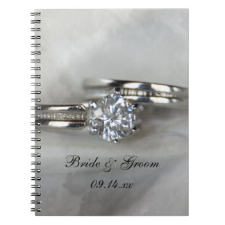 Wedding Rings on Gray Spiral Notebook