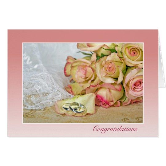 wedding rings on rose petal card
