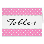 Wedding table place cards with pink background