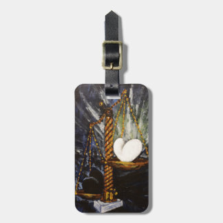 Weight of a heavy and light heart luggage tag