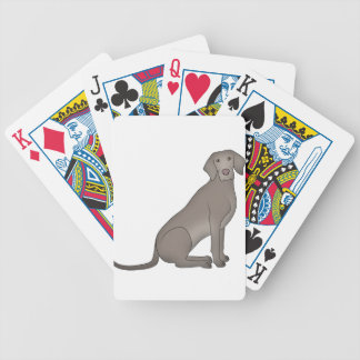 Weimaraner sits bicycle playing cards