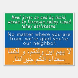 Welcome Neighbors Sign Somali, English, Arabic