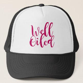 well oiled trucker hat