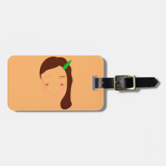 Wellness woman asia on gold luggage tag