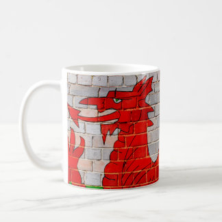 Welsh dragon on a brick wall coffee mug