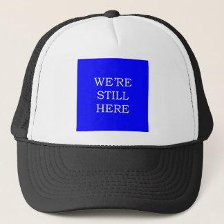 We're Still Here Trucker Hat