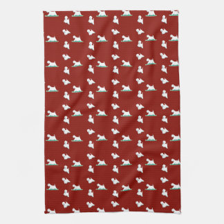 Westie on red kitchen towel