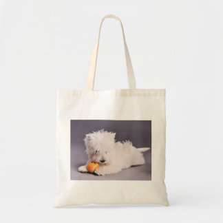 Westie puppy with tennis ball tote bag