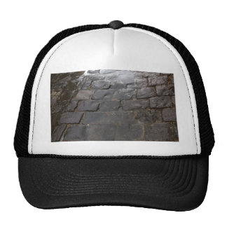Wet Alley -- Blue stone alley covered in water. Trucker Hat