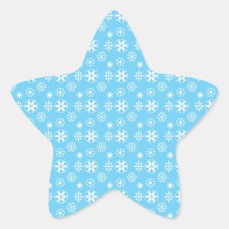 Wet snowflakes on blue star sticker
