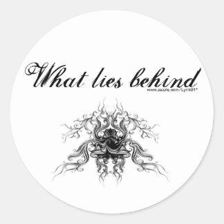 What lies behind round sticker