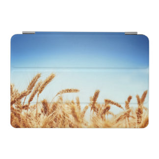 Wheat field against blue sky iPad mini cover