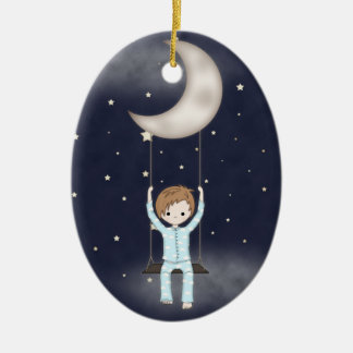 Whimsical Little Boy Swinging from the Moon Ceramic Oval Ornament