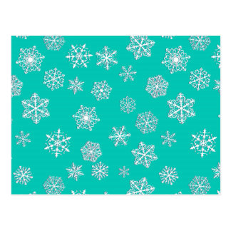 White 3-d snowflakes on a turquoise background postcard