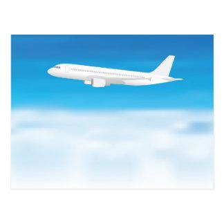 White aeroplane on blue sky cloud background postcard