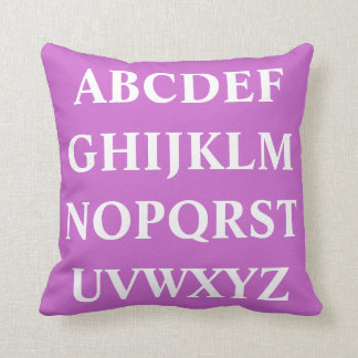 WHITE ALPHABET on bright light purple pillow