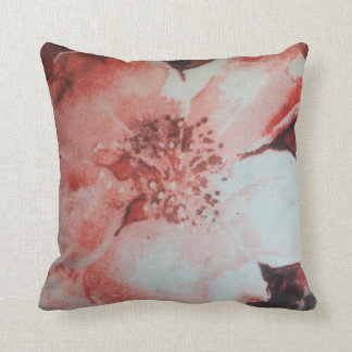 white and red flower throw pillow